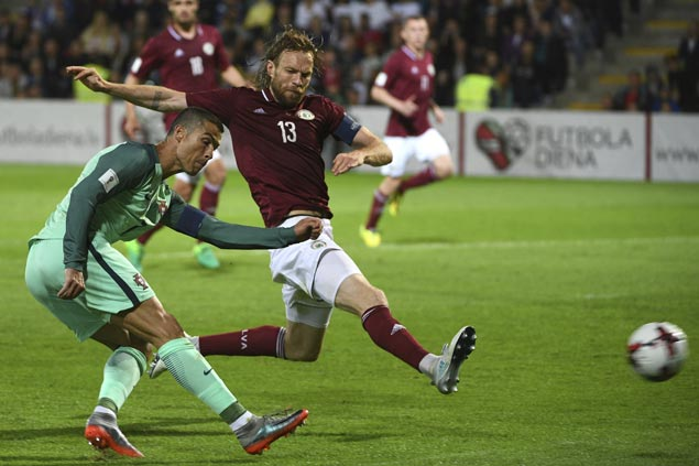 Portugal rips Latvia as Andorra downs Hungary in World Cup qualifierto end long run of futility