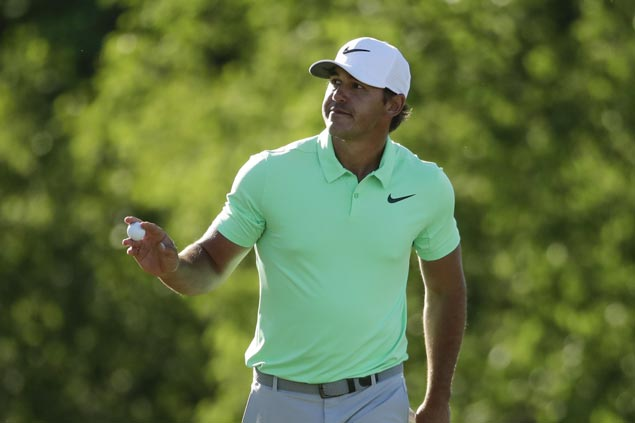 Brooks Koepka hits great recovery shot out of water hazard, sets pace in Shanghai with eight-under 64