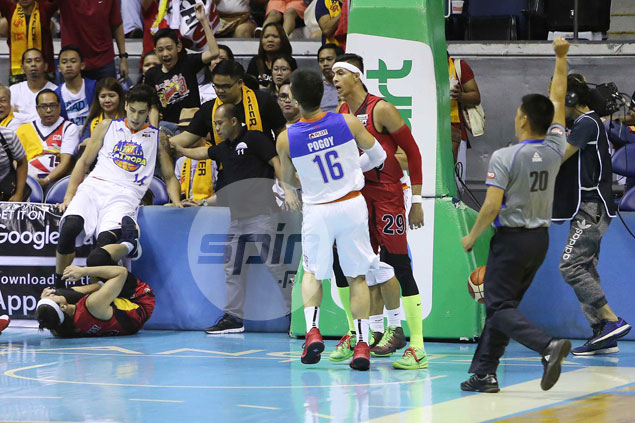 Roger and out: Short night for TNT Game 1 hero Pogoy after hit on Arwind Santos