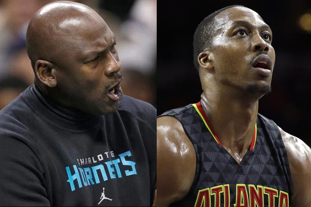 Charlotte recruit Dwight Howard jumps back into the gym after call from Michael Jordan
