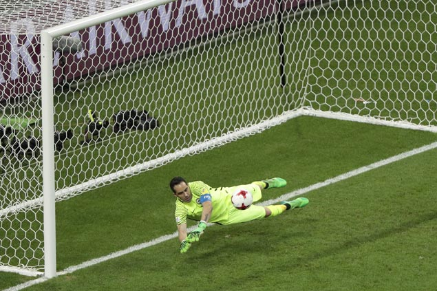 Claudio Bravo makes three penalty saves as Chile beats Portugal in shootout to gain Confed Cup final