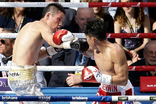 Jerwin Ancajas retains world title with impressive seventh-round TKO win over Kinoshita