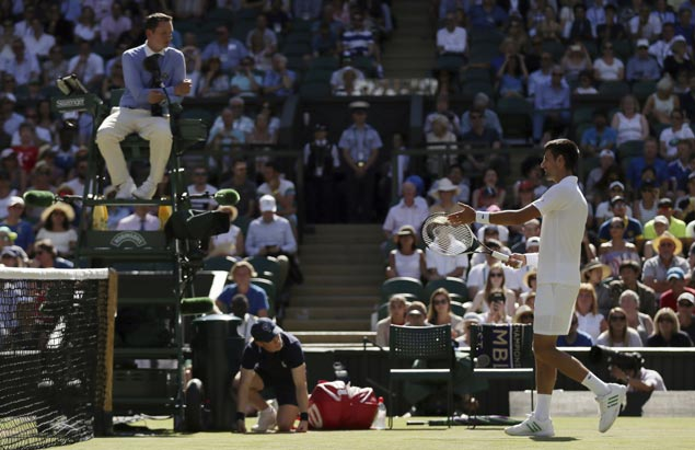 Novak Djokovic tells umpire to 'focus' then eases past Ernests Gulbis and into Round of 16