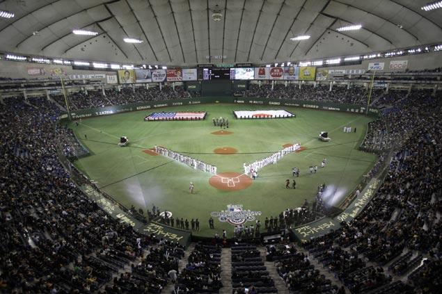 Major League Baseball plans more regular-season games in Asia, England