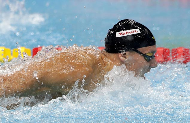Rising swim star Caleb Dressel wins record three gold medals in one night at worlds