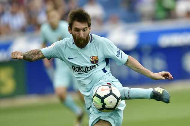 Lionel Messi scores 350th goal in La Ligaas Barcelona downs Alaves