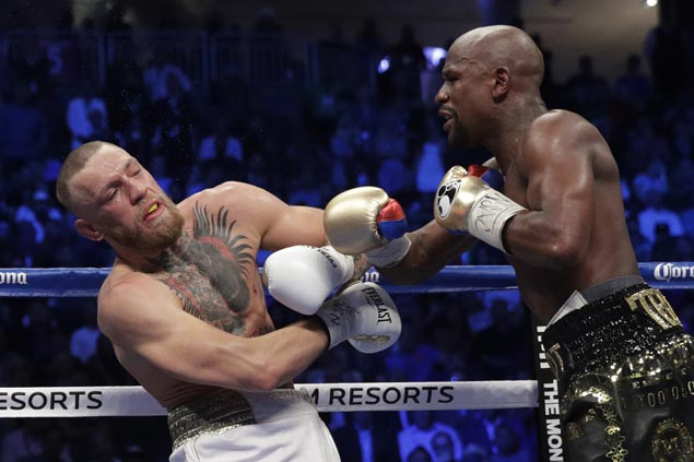 Floyd Mayweather stays perfect with 10th-round TKO as Conor McGregor runs out of gas