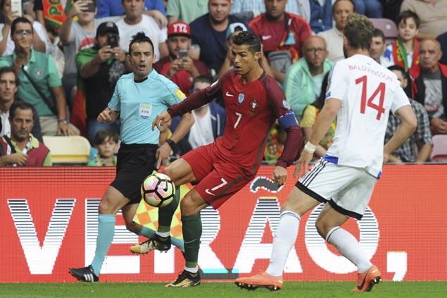 Cristiano Ronaldo passes Pele's mark with hat trick in Portugal's romp vs Faeroe Islands in WC qualifiers
