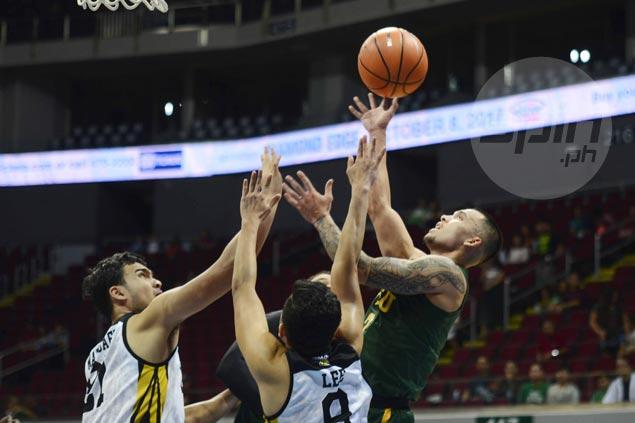 FEU Tamaraws rally in fourth to even record and keep UST Tigers winless