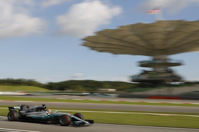 Another brilliant drive earns Lewis Hamilton pole at Sepang as Sebastian Vettel misery continues
