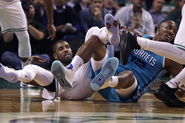 Kyrie Irving helps spark strong start and Celtics hold off Hornets