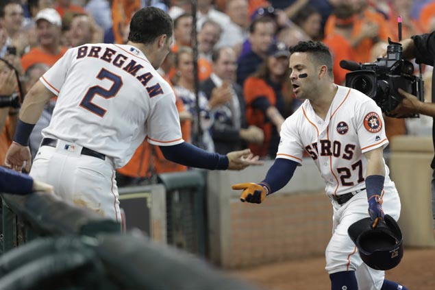 Jose Altuve homers thrice to power Astros romp over Red Sox in ALDS opener