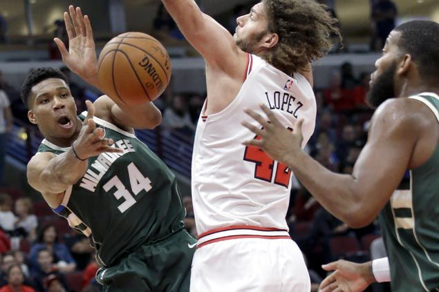 Grieving Giannis Antetokounmpo solid in preseason debut but Bulls beat winless Bucks
