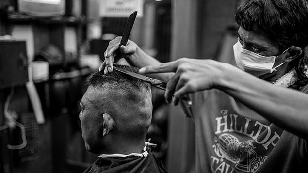 What's it like to live a day in the life of a remarkable small-time barber? See IMAGES