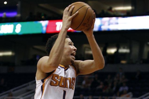 Devin Booker scores 31 points as Phoenix Suns down Brisbane Bullets