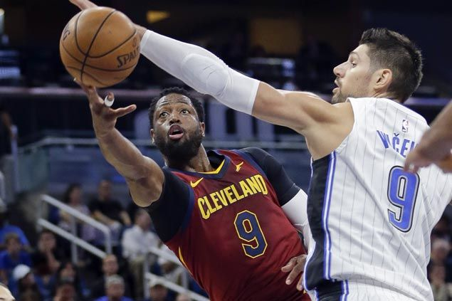 Wade starts hot, Cavs bench heat up in third to beat Magic and end preseason with a win