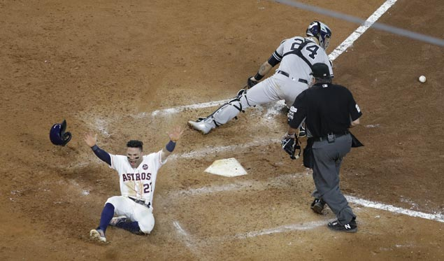 Astros move two games ahead of Yankees in ALCS as Jose Altuve scores on Carlos Correa ninth-inning double