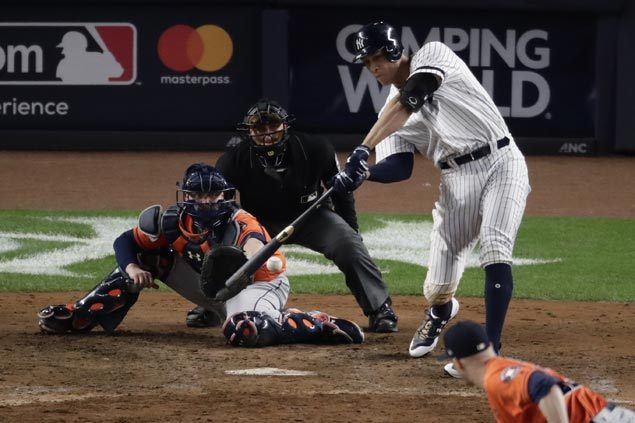 Yankees rally past Astros with four-run eighth inning to level AL Championship Series