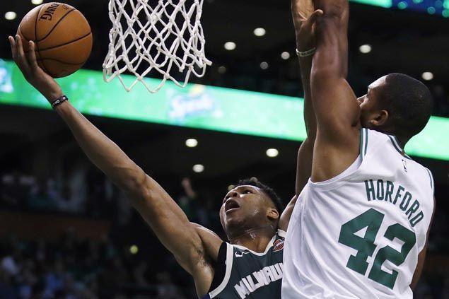Antetokounmpo, Bucks add to Celtics' miseries in somber Boston home opener