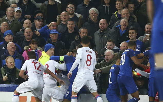 Everton bans fan who aimed punch at Lyon goalkeeper during melee