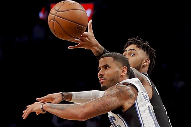 Russell, Booker, Carroll take charge as Lin-less Nets edge Magic