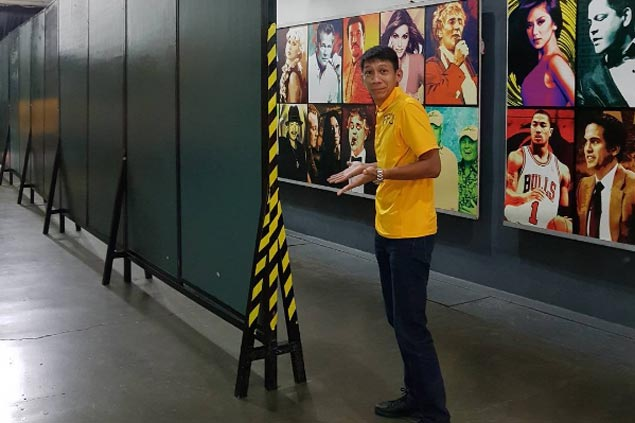 LOOK: TNT coach Nash Racela takes playful jab at new wall separating dugouts inside Big Dome