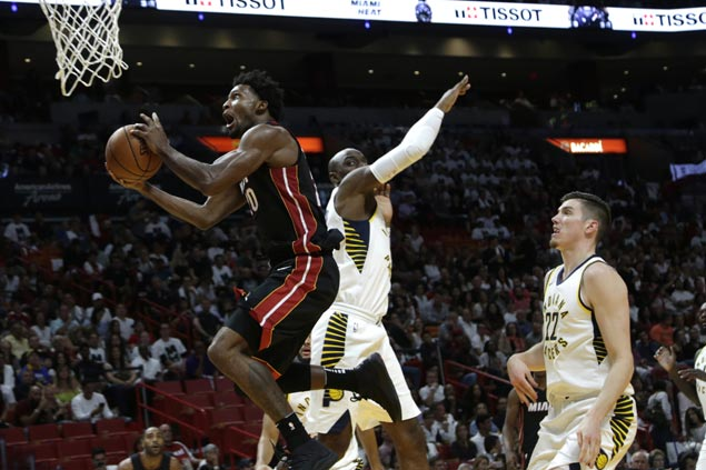 Heat blow huge lead but hang on to beat Pacers