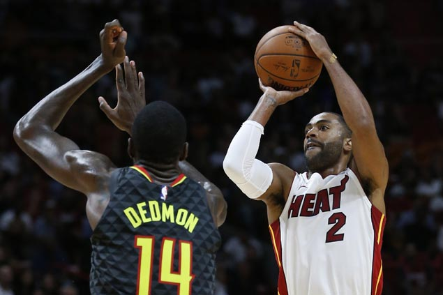 Heat squander 21-point lead but recover to beat Hawks