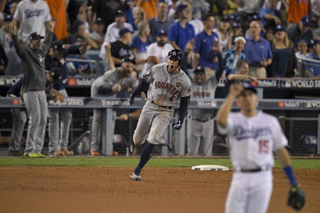 George Springer hits two-run 11th inning homer as Astros nip Dodgers to tie World Series