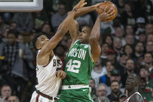 Al Horford, Kyrie Irving lead way as Celtics exact payback over Bucks and stretch win run to three