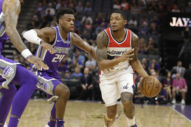 Wizards arrest two-game slide with rout of Kings