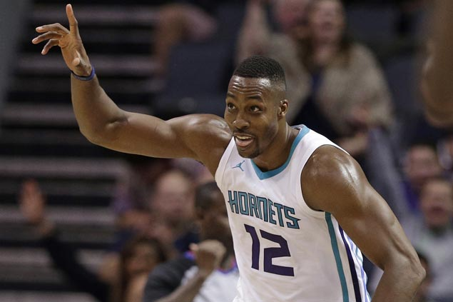 Double-doubles by Kemba Walker, Dwight Howard power Hornets past Magic