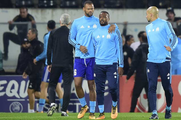 Patrice Evra charged with violent conduct, slapped with initial one-game ban for kicking fan