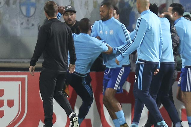 Marseille's Patrice Evra sent off before Europa League match for aiming kick at fan