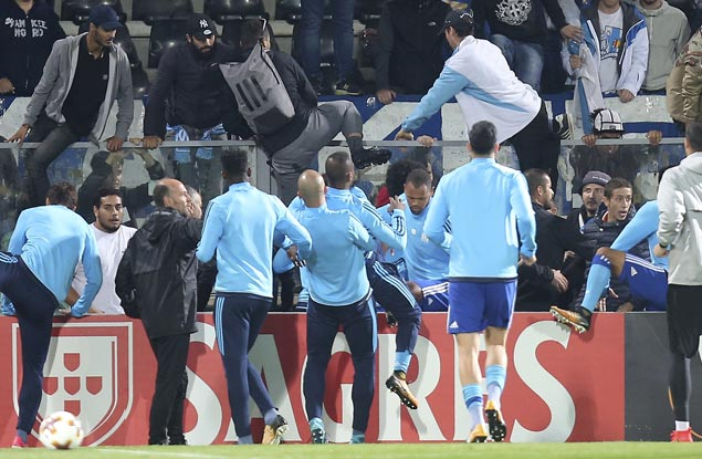 Patrice Evra fired by Marseille, banned by Uefa for kicking fan at Europa League match