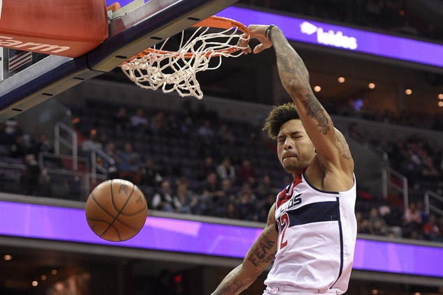 Balanced offense powers Wizards to victory over Kings