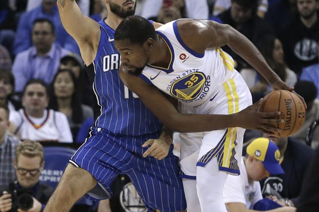 Curry-less Warriors ride another third quarter surge to beat Magic for seventh straight win