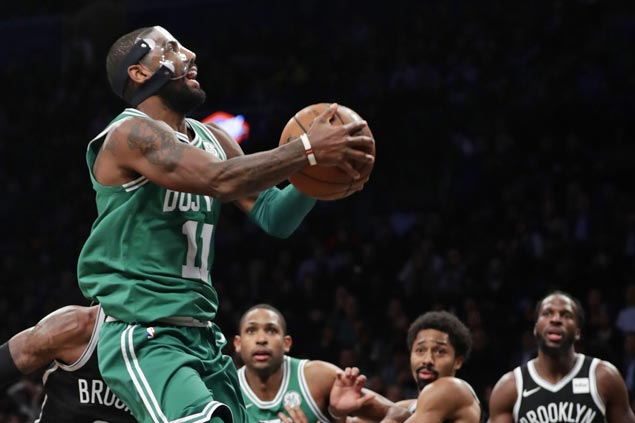 Celtics nip Nets to make it 13 straight wins as Kyrie Irving returns after sustaining facial fracture
