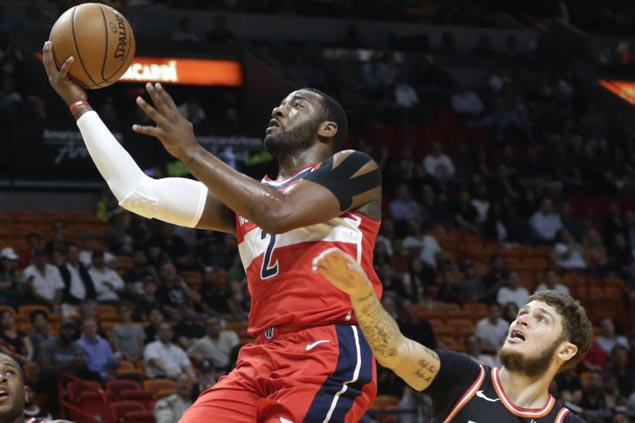 Wizards survive dreadful third quarter to end run of futility against Heat