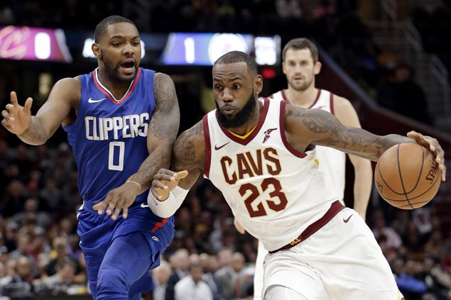 Cavs survive scare from skidding Clippers, win in overtime to stretch streak to four