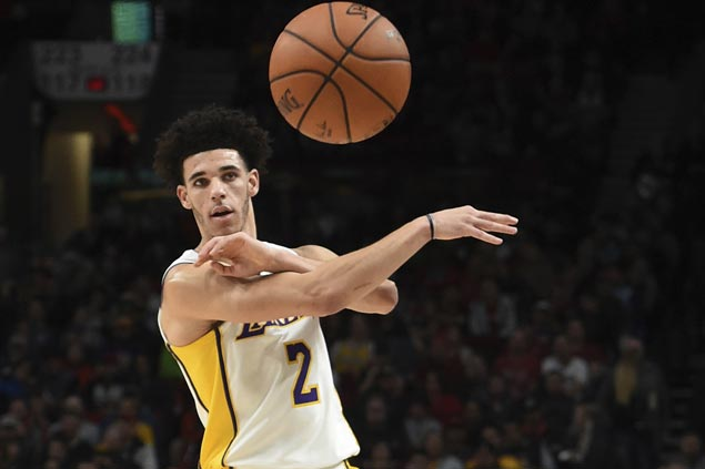 Lonzo Ball posts triple-double in Lakers' win over Nuggets as Jokic gets tossed, Millsap injures wrist