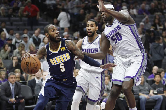 Missing coach and two starters, Nuggets manage to beat Kings and get back on track