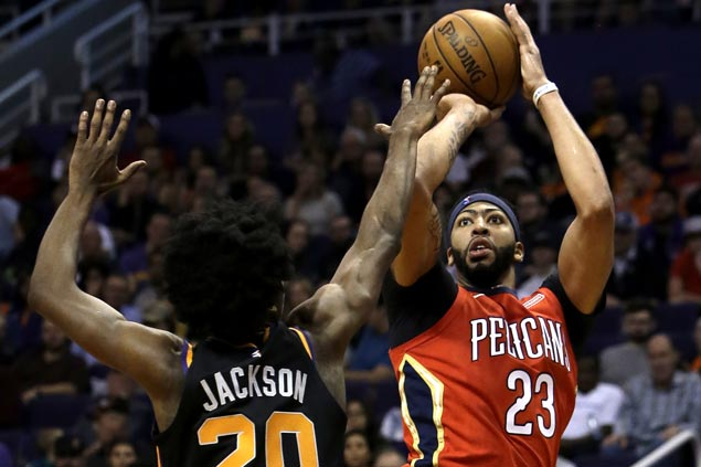 Boogie and Brow take control early then sit and watch Pelicans rip Suns