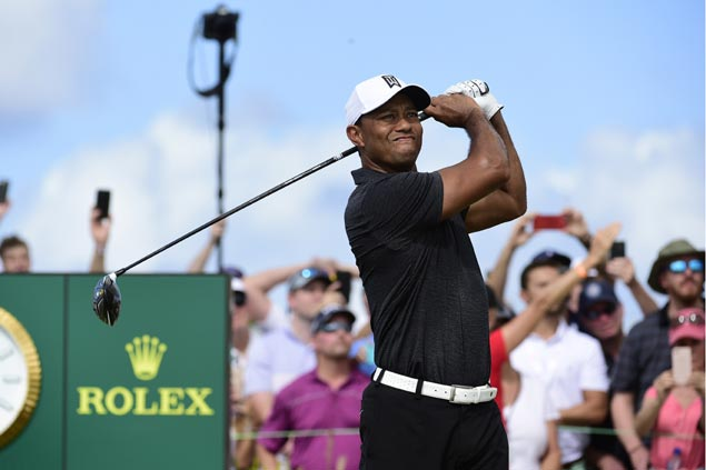 Tiger Woods just three shots behind lead in Bahamas in first game back after long injury layoff