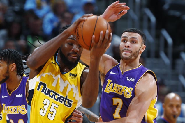 Shorthanded Nuggets rally in fourth to send Lakers to fourth straight loss