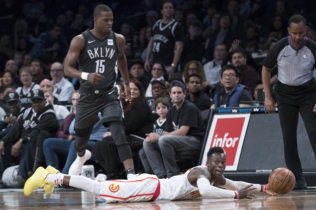 Undermanned Hawks use balanced scoring to defeat Nets or third road win of season