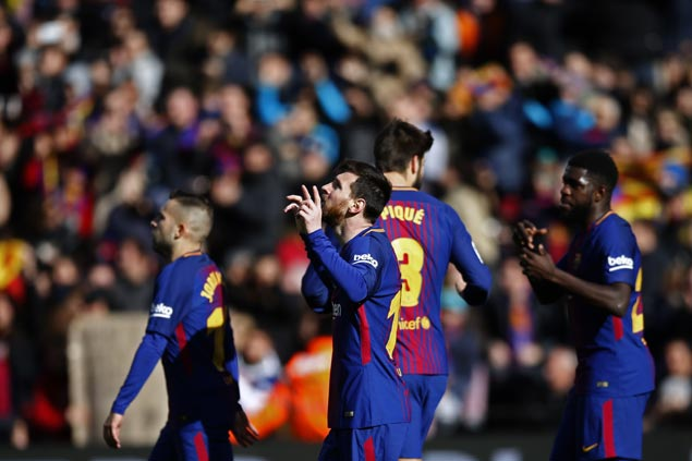 Valencia fails to close gap on La Liga leader Barcelona after loss to 10-man Getafe