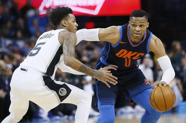 Westbrook's triple-double, clutch three lift Thunder in squeaker over shorthanded Spurs