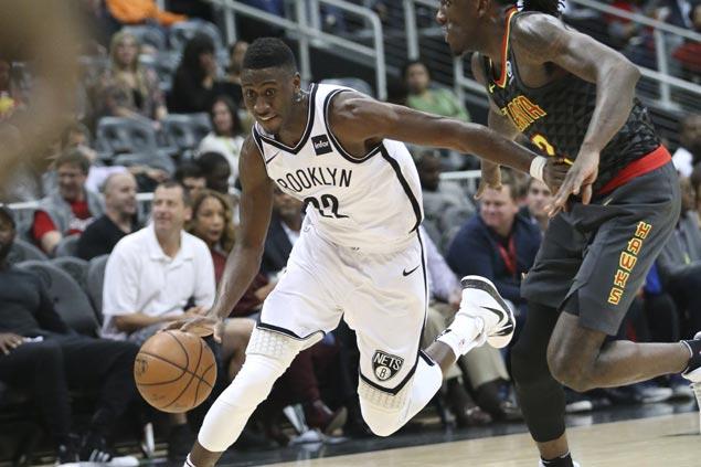 Nets ride blistering third quarter blitz to vengeful win over lowly Hawks