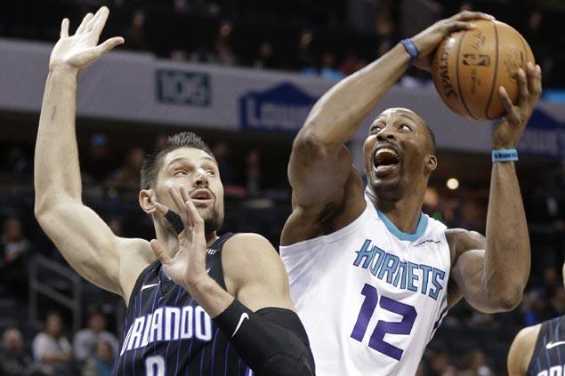 Kemba Walker, Dwight Howard lift Hornets over Magic to halt four-game slide